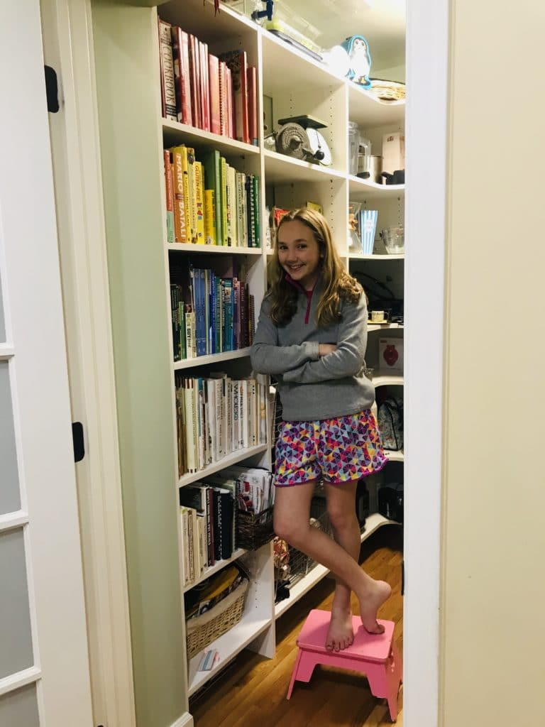 Noelle and Her Rainbow Colored Pantry Bookcase!