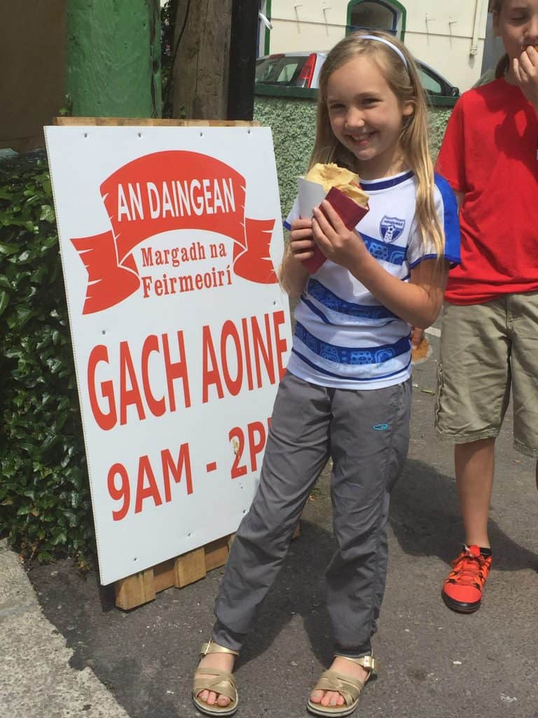Ireland With Kids - Noelle eating a gluten-free crepe at the Dingle Farmers Market