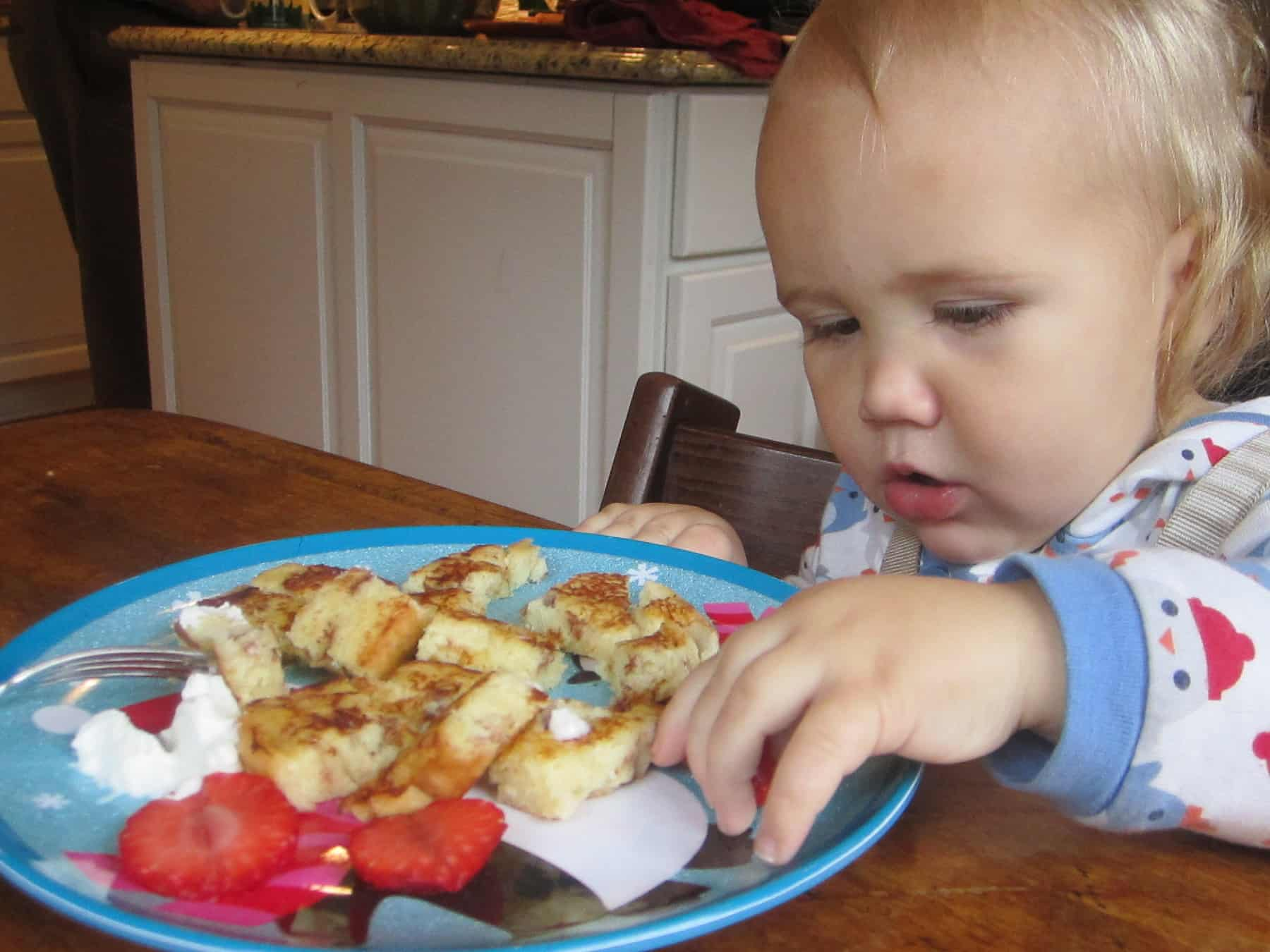 baby eating french toast