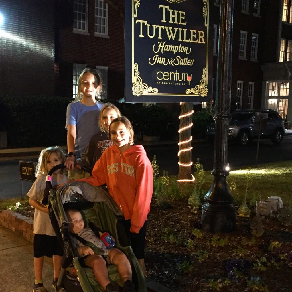 Kids in front of the Tutwiler Hotel