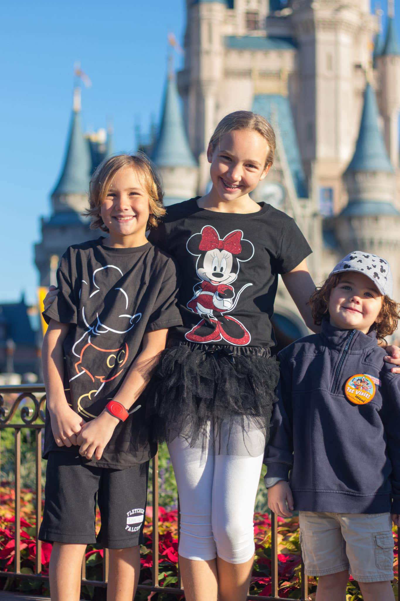 three kids at Disney in December