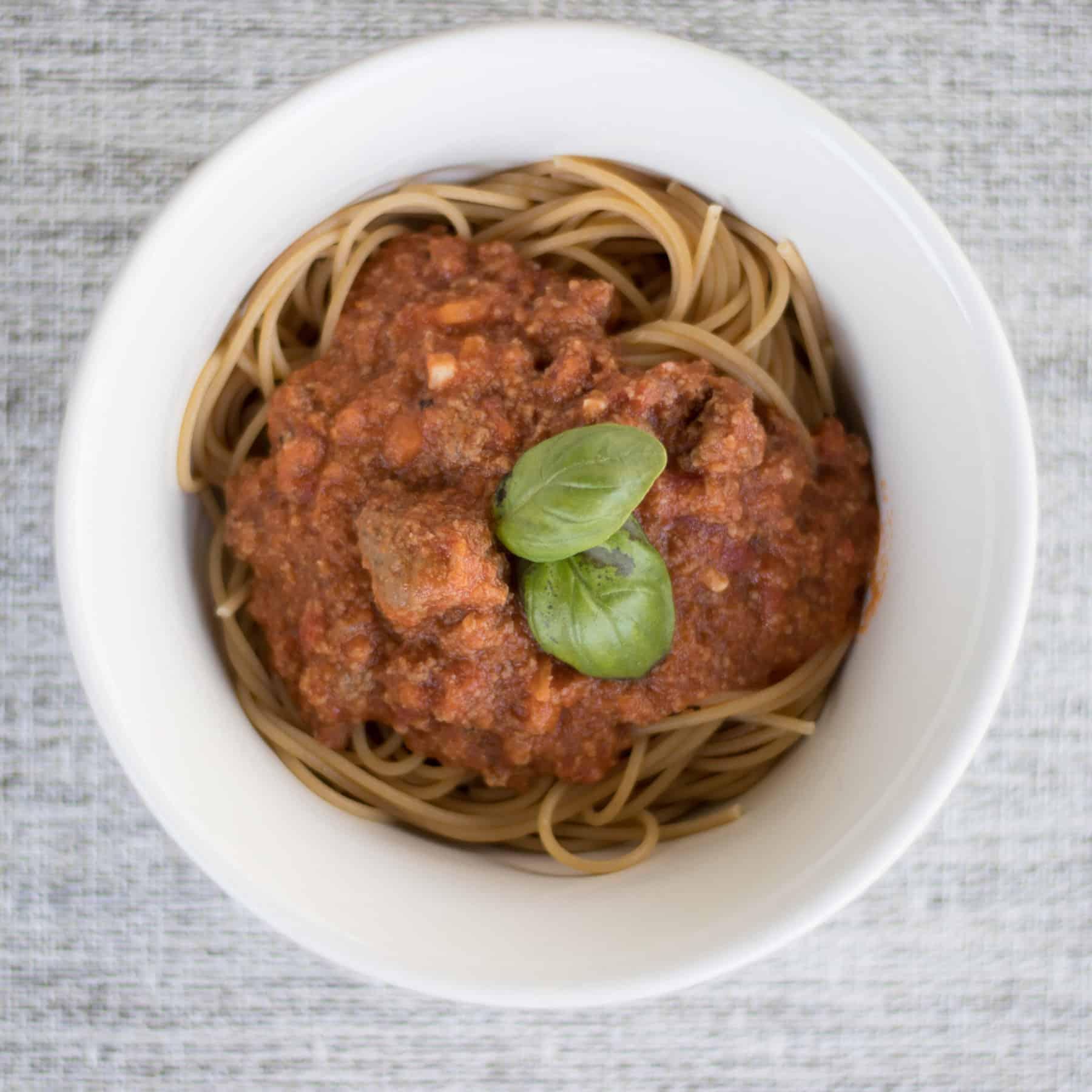 bolognese sauce over spaghetti