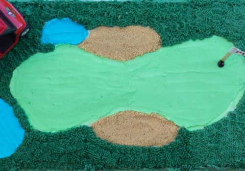 Golf course birthday cake with golf cart